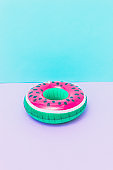 pool toy in shape of watermelon on pastel pink and blue background