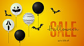 Halloween Sale lettering with scary balloons and bats