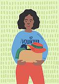 African female volunteer holding donation box.