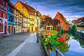 Medieval colorful facades reflecting in water at morning, Colmar, France