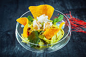 modern serve guacamole in a glass. Mexican food. Avocado. Guacamole and Nacho. Appertiv, appetizer. copy space. Spicy food