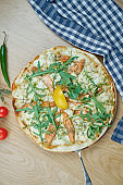Italian, homemade pizza with salmonon dor blue cheese a wooden table. Top view food with copy space. Flat lay