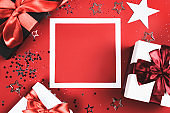 Present boxes on red background.