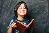 Young Boy Student holding books