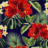 Seamless pattern, red lilies, plumeria flowers and tropical plants and palm leaves.