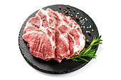 Raw sliced pork meat on stone board, isolated on white background