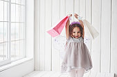 Gift time. Beautiful little girl with fairy costume having fun posing for the pictures