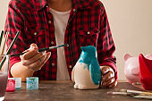 Adult Woman Hands Painting Coin Banks