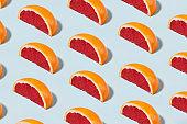 Grapefruit Pattern on Soft Blue Background
