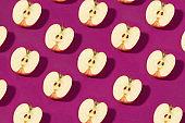 Half Sliced Apple Fruit Pattern on Purple Background