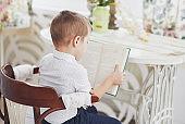 Boy reading a book. Getting ready for school
