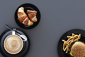 Coffee cup and croissant and hamburger in the plate on grey background. 3d render