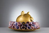 Piggy Bank in a Gold Colored Plate