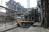 landscape, panorama, view of factory slums with metal hulls and machines for the production of the coking industry, smoking pipes and reconstruction of a plant in Ukraine