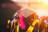 Graduates receive a certificate of graduation at the university.