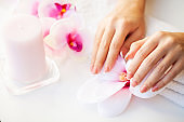 Nails care. Beautiful woman's nails with french manicure, in beauty studio