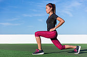 Fitness woman doing lunges leg workout exercises