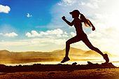Silhouette athlete runner running in sunset