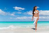 Beach Asian woman in fashion beachwear cover-up skirt clothing