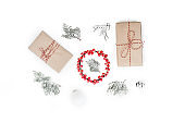 Christmas composition. Gifts with red decorations on white background