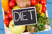 Inscription diet and fruits with vegetables as healthy nutritious snack or dessert containing vitamins