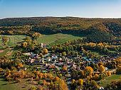 little thuringian village in colorful autumn landscape