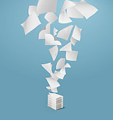 Flying paper and stack of papers on blue background.