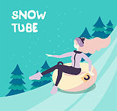 Vector cartoon flat girl in hat sledging along the slope with fir trees at inflatable tube, snowtubing outdoors in winter with long hairs. Young woman sledding on snow rubber tube. Winter activity