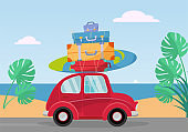 Little red retro car rides from the sea with stack of suitcases on roof. Flat cartoon vector illustration. Car side View With surfboard and baggage. Southern landscape with sand, leaves of Monstera