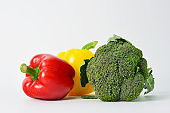 Broccoli and sweet pepper isolated on white background.