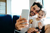 Father with daughter taking selfie