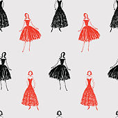 Seamless background of silhouettes of fashionable women