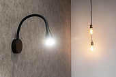 Wall with bulb light lamps in modern interior, copy space