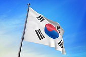 South Korea flag waving in the blue sky