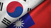 Taiwan and South Korea two flags together textile cloth, fabric texture