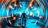 Journey to the unknown as man stands in futuristic looking corridor surrounded by light