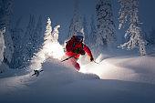 Strom skiing in fresh powder.