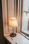 Table lamp by the window