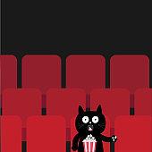 Cat sitting in movie theater eating popcorn.  Cute cartoon character. Film show Cinema background. Viewer kitten watching movie. Red seats hall. Dark background. Flat design