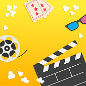 Popcorn. Open clapper board from top down perspective. Air view. Movie reel. 3D glasses. Two tickets. Cinema icon set in flat design style. Pop corn popping. Yellow gradient background. Fast food.