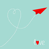 Red origami paper plane. Dash line heart in the blue sky. Love card. Heart symbol. Happy Valentines Day. Cute background. Isolated.
