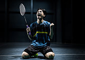 Asian badminton player is glad that he wins competition