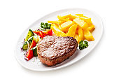 Grilled beef steak with french fries and vegetables