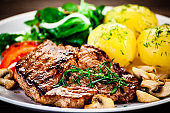 Grilled steak with french fries and vegetable salad