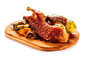 Roast duck on cutting board on white background