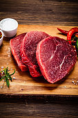 Fresh raw beef on stone cutting board