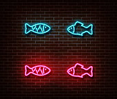 Neon fish signs vector isolated on brick wall.
