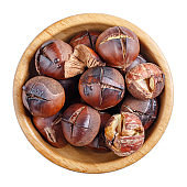 Roasted edible sweet chestnuts in wooden bowl isolated on white background. Top view.