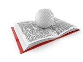 Golf ball on open book