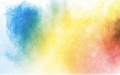 Colorful background of pastel powder explosion.Multi colored dust splash on white background.